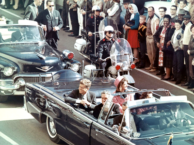 John F. Kennedy in the presidential motorcade before the assassination in Dallas